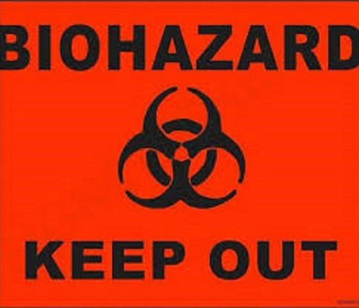 "Red background with a biohazard sign and ""biohazard keep out"" printed"